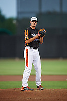 Aberdeen IronBirds relief pitcher Kevin Magee (39) gets ready to deliver a pitch during a game against the Staten Island Yankees on August 23, 2018 at Leidos Field at Ripken Stadium in Aberdeen, Maryland.  Aberdeen defeated Staten Island 6-2.  (Mike Janes/Four Seam Images)