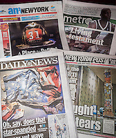 Front pages and headlines of the New York tabloids on Thursday, May 15, 2014 feature coverage of the opening of the National September 11 Memorial & Museum in Lower Manhattan.  (© Richard B. Levine)