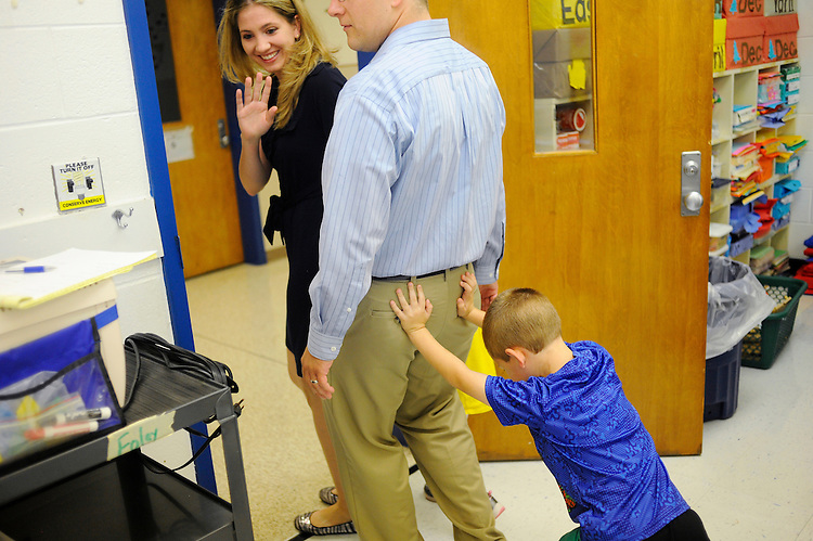 Kindergartener Zander Simmons pushes his mom Kelly and dad Chris out the door after they visited his classroom for the first couple minutes of his first ever day of school at H.M. Pearson Elementary school in Catlett.