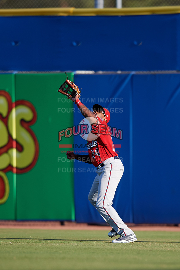 Fort Myers Miracle right fielder Jaylin Davis (24) settles under a fly ball during a game against the Dunedin Blue Jays on April 17, 2018 at Dunedin Stadium in Dunedin, Florida.  Dunedin defeated Fort Myers 5-2.  (Mike Janes/Four Seam Images)