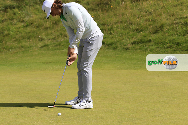 Tommy Fleetwood (ENG) takes his putt on the 2nd green during Saturday's Round 3 of the 2017 Dubai Duty Free Irish Open held at Portstewart Golf Club, Portstewart, Co Derry, Northern Ireland. 08/07/2017<br /> Picture: Golffile | Eoin Clarke<br /> <br /> <br /> All photo usage must carry mandatory copyright credit (&copy; Golffile | Eoin Clarke)