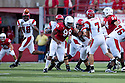 26 September 2009: Louisiana-Lafayette quarterback Chris Masson throwing under pressure from Nebraska defensive end Barry Turner to tight end Ladarius Green during the first quarter at Memorial Stadium, Lincoln, Nebraska. Nebraska defeats Louisiana Lafayette 55 to 0.