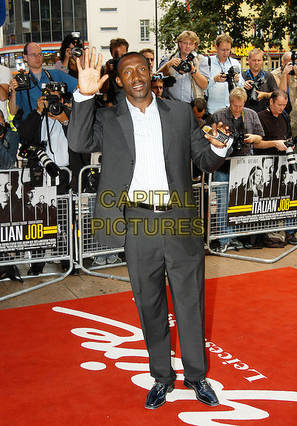 "LINFORD CHRISTIE .lynford.waving, Nokia mobile phone.""The Italian Job"" premiere.Empire cinema, Leicester Square.sales@capitalpictures.com.www.capitalpictures.com.©Capital Pictures"
