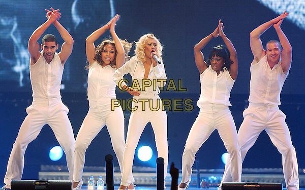 "CHRISTINA AGUILERA.Performs on her ""Back To Basics Tour"" held at the Quicken Loans Arena, Cleveland, Ohio, USA..April 12th, 2007.stage concert live gig performance music full length white trousers high waist back up dancers singing suspenders braces singing shirt .CAP/ADM/DS.©Devin Simmons/AdMedia/Capital Pictures"