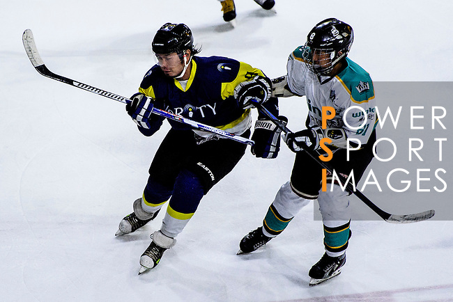 Verity Skater #9 Paul Chai (l) battle for the puck  with Medical Kings Forward #81 Keith Tsang (r) during the Principal Standard League match between Medical Winner Kings vs Verity at the Mega Ice on 17 January 2017 in Hong Kong, China. Photo by Marcio Rodrigo Machado / Power Sport Images