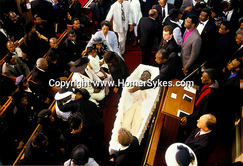 MOURNERS SITTING IN PEWS WITH CORPSE IN OPEN COFFIN AT FUNERAL SERVICE IN CHURCH, NEW TESTAMENT OF GOD, LONDON,