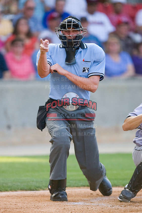 Home plate umpire Travis Carlson makes a strike call during a Southern League game between the Jacksonville Suns and the Carolina Mudcats at Five County Stadium May 15, 2010, in Zebulon, North Carolina.  Photo by Brian Westerholt /  Seam Images