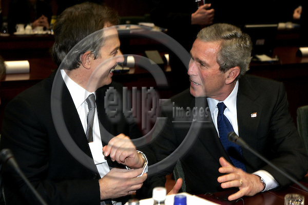 "BRUSSELS - BELGIUM - 22 FEBRUARY 2005 --EU-US Summit.--The President of the United States of America George W. BUSH with the British Prime Minister Tony BLAIR (L).--  PHOTO: JUHA ROININEN / EUP-IMAGES..This picture is copyright EUP-IMAGES and all rights belong to EUP-IMAGES. The picture may not be subject to RESALE or storage in any kind in electronical or analog way.  If published due to the above EU-US summit meeting in Brussels in print or electronical form the publication must inform on the use to the e-mail address ""eup@eup-images.com"". All further use of this picture may only be done by contacting www.eup-images.com..."