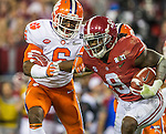 Alabama running back Bo Scarborough stiff arms Clemson  linebacker Dorian O'Daniel in the first half of the 2017 College Football Playoff National Championship in Tampa, Florida on January 9, 2017.  Photo by Mark Wallheiser/UPI