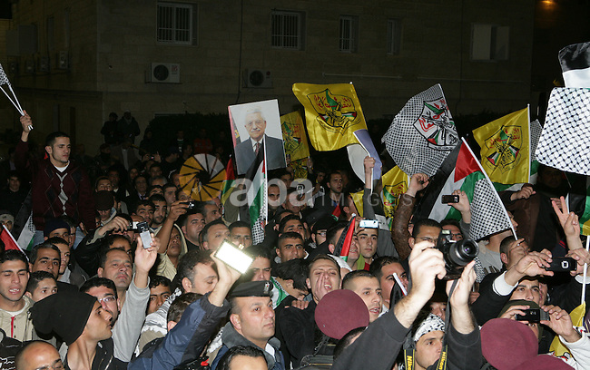 Palestinians take part in a march to show support and pro-security council decision against Israeli settlements, in the West Bank city of Ramallah on Feb. 18,2011. Photo by Thaer Ganaim