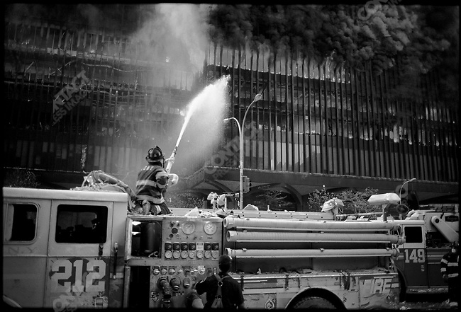 Firefighters at ground zero, after terrorist attack and destruction of the World Trade Center, New York City, New York, USA, September 11, 2001