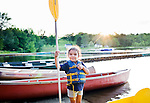 Watertown, CT- 19 August 2015-081915CM07- Ariana Estrada 5 of Waterbury, waits on the beach with a paddle during canoe rides during family night at Camp Mataucha in Watertown on Wednesday, August 20th. 2015.  Christopher Massa Republican-American