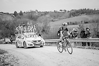 race leader Michal Kwiatkowski (POL/SKY) attacking the last gravel hill solo with the neutral service car right behind him<br /> <br /> 11th Strade Bianche 2017