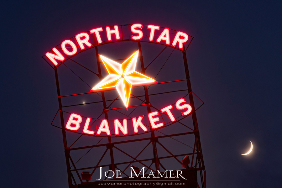 Illuminated North Star Blankets sign in downtown Minneapolis, Minnesota.