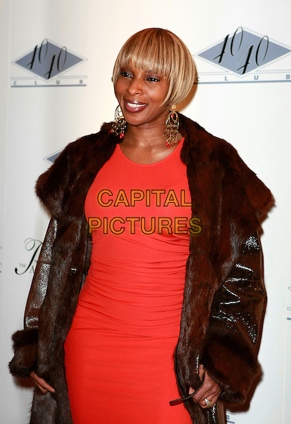 MARY J. BLIGE.Grand Opening of Jay-Z's 40/40 Club In Las Vegas located inside The Palazzo, Las Vegas, Nevada, USA,.30 December, 2007..half length blonde hair bob fringe orange red dress brown coat fur  gold earrings .CAP/ADM/MJT.©MJT/AdMedia/Capital Pictures.
