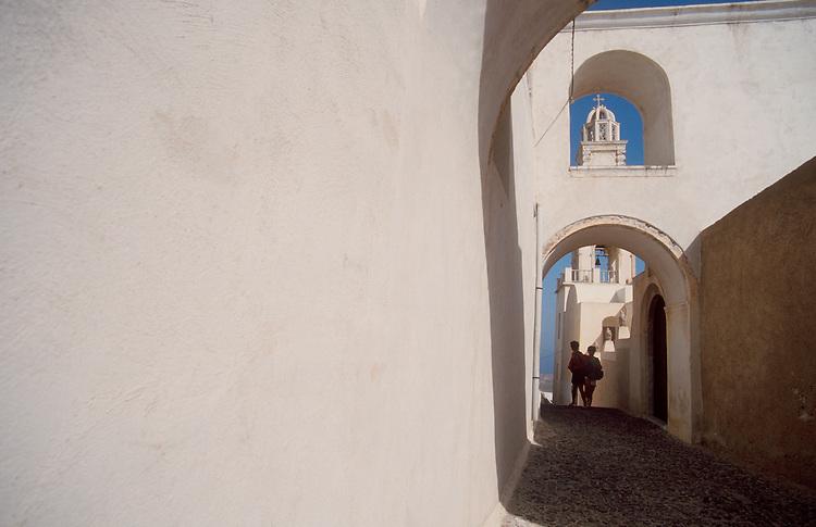 Greece, Santorini, Tourists walk the car-free streets of Thira, Greek Isles, Mediterranean Sea, .