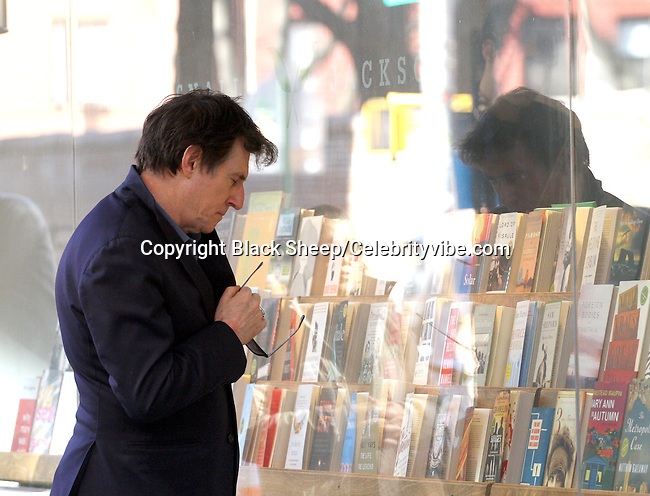 Gabriel Byrne.Gabriel Byrne peruses some books while taking a stroll.Streets of NolitaNew York, NY, USA.Thursday, March 17, 2011.Photo By CelebrityVibe.com.To license this image please call (212) 410 5354; or Email: CelebrityVibe@gmail.com ; website: www.CelebrityVibe.com**EXCLUSIVE**