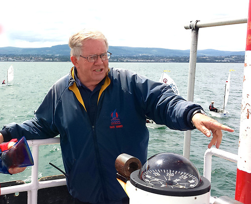 Former Irish Sailing President David Lovegrove of Howth implementing some of the lessons he learned from Ron Hutchieson as he sets the programme in action at an Optimist Championship