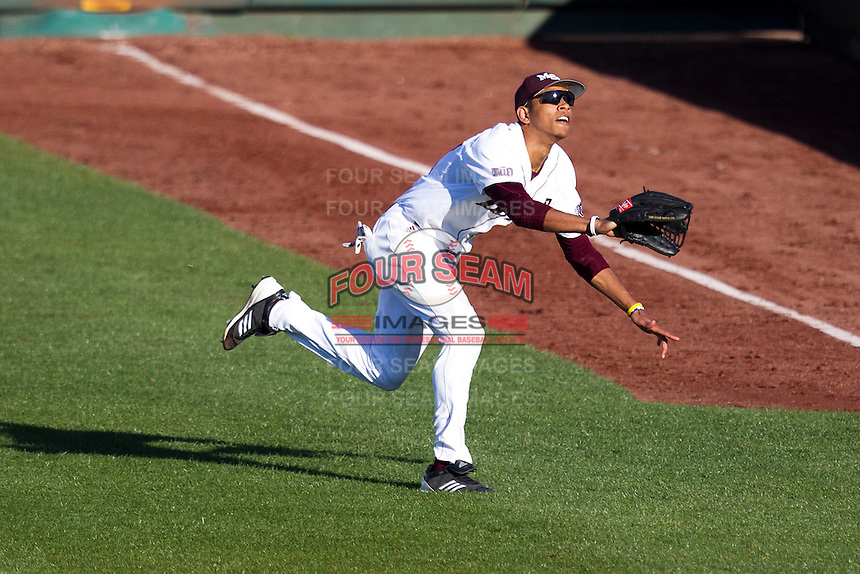 Trey Massenberg (12) of the Missouri State Bears eyes a fly ball in right field during a game against the Southern Illinois University- Edwardsville Cougars at Hammons Field on March 9, 2012 in Springfield, Missouri. (David Welker / Four Seam Images)