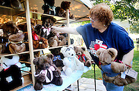 NWA Democrat-Gazette/DAVID GOTTSCHALK  Lynda Ellenburg, of Lincoln, with Attic Trunk Teddy Bears, sets up her display area Friday, September 4, 2015 at the 64th annual Clothesline Fair at Fair at Prairie Grove Battlefield State Park. The Teddy Bears are based on a 1974 pattern and made from repurposed fur coats. The fair opens today and runs through Monday.