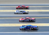 Apr. 14, 2012; Concord, NC, USA: NHRA pro stock drivers (top to bottom) Grace Howell , Allen Johnson , Shane Gray and Kurt Johnson race four wide during qualifying for the Four Wide Nationals at zMax Dragway. Mandatory Credit: Mark J. Rebilas-