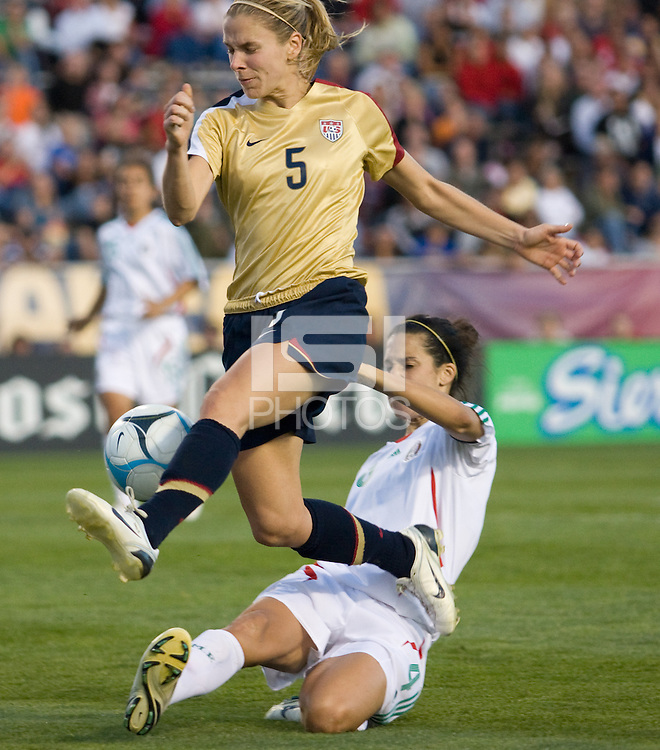 Lindsay Tarpley tries to shoot on goal in front of a sliding Monica Gonzalez..International friendly, USA Women vs Mexico, Albuquerque, NM,.October 20, 2006..USA 1, Mexico 1.