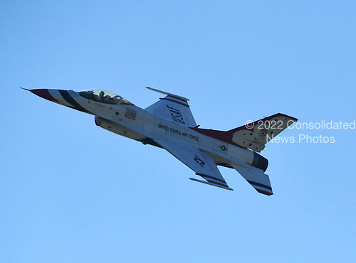 """An F-16 Fighting Falcon aircraft operated by the United States Air Force """"Thunderbirds"""" perform at the Joint Base Andrews Air Show at Joint Base Andrews, Maryland on Friday, September 15, 2017. The Thunderbirds are assigned to the 57th Wing, and are based at Nellis Air Force Base, Nevada.<br /> Credit: Ron Sachs / CNP"""