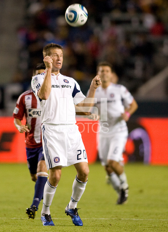 Brian McBride Captain and forward of the Chicago Fire during McBrides last game of his career heads a ball. The Chicago Fire defeated CD Chivas USA 3-1 at Home Depot Center stadium in Carson, California on Saturday October 23, 2010.