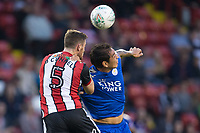 Leonardo Ulloa of Leicester City battles for a header with Jack O'Connell of Sheffield United during the Carabao Cup match between Sheffield United and Leicester City at Bramall Lane, Sheffield, England on 22 August 2017. Photo by James Williamson / PRiME Media Images.