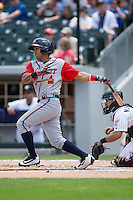 Emerson Landoni (27) of the Gwinnett Braves follows through on his swing against the Charlotte Knights at BB&T BallPark on May 22, 2016 in Charlotte, North Carolina.  The Knights defeated the Braves 9-8 in 11 innings.  (Brian Westerholt/Four Seam Images)