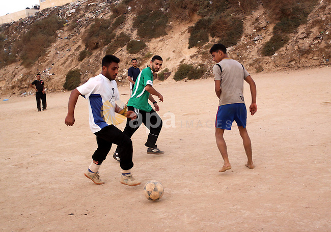 Palestinian youths play football at the beach Gaza city on June 11,2010, in the first day of starting the World Cup 2010 in South Africa. Photo by Mohammed Asad