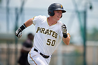 GCL Pirates third baseman Patrick Dorrian (50) runs to first base during a game against the GCL Tigers West on August 13, 2018 at Pirate City Complex in Bradenton, Florida.  GCL Tigers West defeated GCL Pirates 5-1.  (Mike Janes/Four Seam Images)