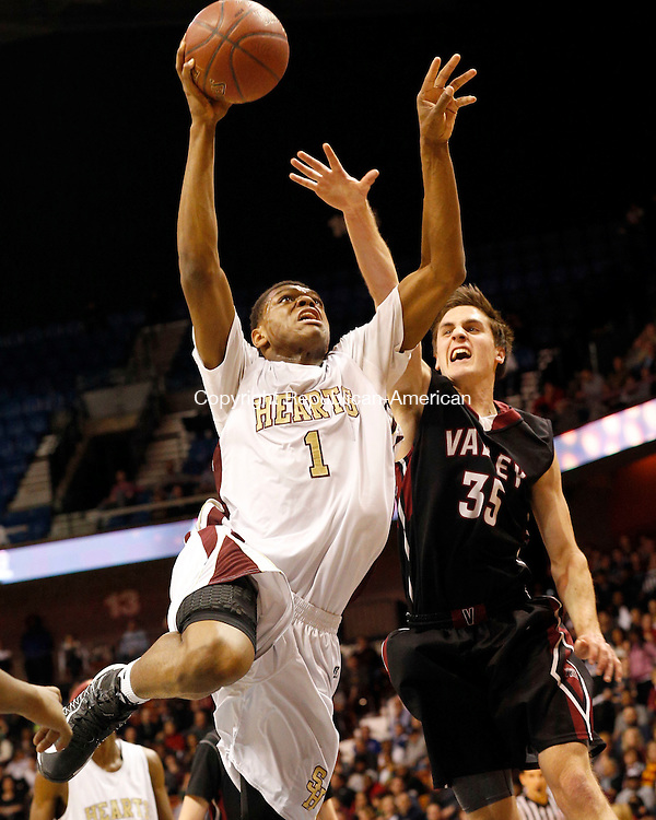 Uncasville, CT- 22 March 2015-032215CM24- Sacred Heart's Malik Petteway goes for two against Valley Regional's Hunter Linfesty during their Class S state championship game at Mohegan Sun Arena in Uncasville on Sunday. The Hearts won, 71-46.    Christopher Massa Republican-American