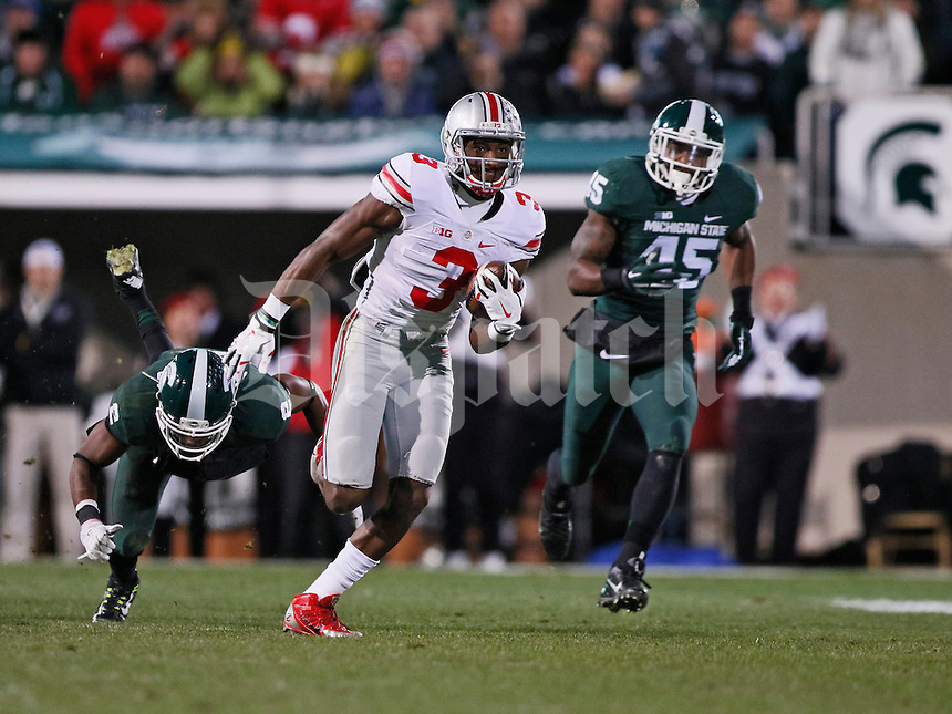 Ohio State Buckeyes wide receiver Michael Thomas (3) catches a 79-yard touchdown pass ahead of Michigan State Spartans cornerback Darian Hicks (2) and linebacker Darien Harris (45) during the second quarter of the NCAA football game at Spartan Stadium in East Lansing, Michigan on Nov. 8, 2014. (Adam Cairns / The Columbus Dispatch)