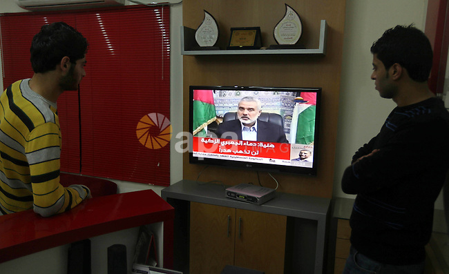 Palestinians watch TV during a speech of Palestinian Prime Minister in Gaza strip Ismail Haniyeh on Al Aqsa television Thursday, Nov. 15, 2012. Haniyeh eulogized Hamas military chief Ahmed Jabari, who was killed Wednesday in an Israeli airstrike, in a televised speech on Thursday night. Palestinian militants barraged Israel with more than 200 rockets on Thursday, killing three people as Israel pressed a punishing campaign of airstrikes on militant targets across the Gaza Strip. Three rockets targeted the densely populated Tel Aviv area, setting off air raid sirens in attacks that trigger an Israeli ground invasion of Gaza. Photo by Majdi Fathi