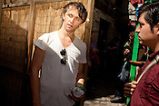 Sondre Lerche speaks to one of his fans, Rudy Villarreal (22), after his set at the Flamingo Cantina in Austin, Texas during the 2011 SXSW Music Festival.