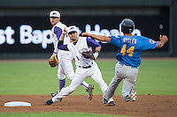 Winston-Salem Dash shortstop Eddy Alvarez (1) turns a double play as Jason Vosler (44) of the Myrtle Beach Pelicans slides into second base in game one of the Carolina League Southern Division Championship series at BB&T Ballpark on September 9, 2015 in Winston-Salem, North Carolina.  (Brian Westerholt/Four Seam Images)