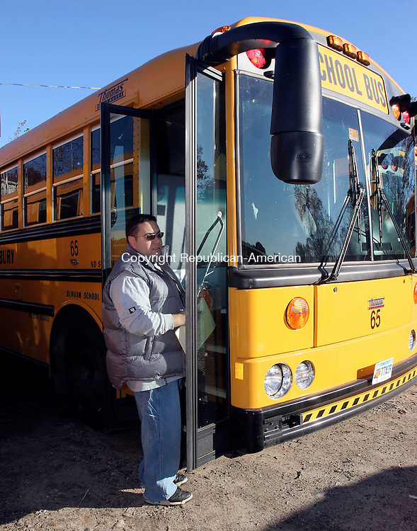 WATERBURY, CT-30October 2006-103006TK02- Bus drivers inspect damaged doors on some of the new school buses.  Tom Kabelka Republican-American ( (Vandals damages, Durham School Services)