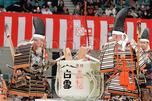 10.01.2011 Tokyo, Japan - Officials dressed in an ancient samurai warrior armors break open a keg of sake rice wine in a traditional Kagami-biraki ceremony to kick off new years first martial arts training at Tokyos Budokan Martial Arts Hall. The tradition of Kagami-biraki was originated in 15th century among samurais to officially start the first workout of the new year.