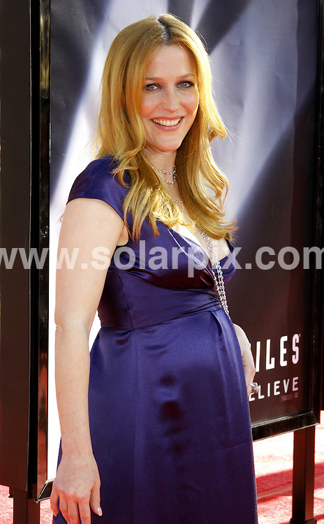 """**ALL ROUND PICTURES FROM SOLARPIX.COM**.**SYNDICATION RIGHTS FOR UK, SPAIN, PORTUGAL, AUSTRALIA, S.AFRICA & DUBAI (U.A.E) ONLY**.""""The X-Files - I want To Believe"""" Hollywood Premiere at the Mann Chinese Theater, Hollywood, CA, USA. July 23, 2008..This pic: Gillian Anderson..JOB REF: 6902 PHZ/David Gabber    .DATE: 23_07_2008.**MUST CREDIT SOLARPIX.COM OR DOUBLE FEE WILL BE CHARGED* *UNDER NO CIRCUMSTANCES IS THIS IMAGE TO BE REPRODUCED FOR ANY ONLINE EDITION WITHOUT PRIOR PERMISSION*"""