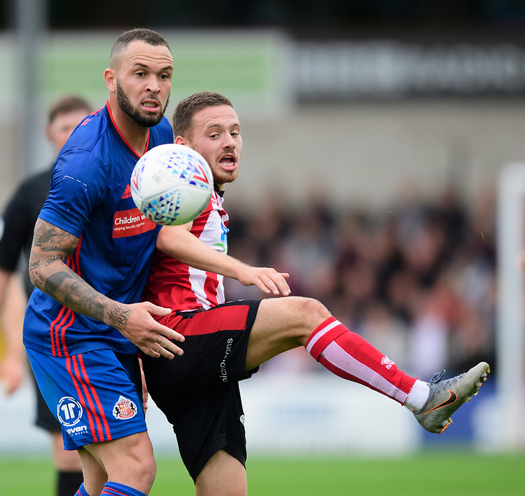 Lincoln City's Jack Payne vies for possession with Sunderland's Joel Lynch<br /> <br /> Photographer Chris Vaughan/CameraSport<br /> <br /> The EFL Sky Bet League One - Lincoln City v Sunderland - Saturday 5th October 2019 - Sincil Bank - Lincoln<br /> <br /> World Copyright © 2019 CameraSport. All rights reserved. 43 Linden Ave. Countesthorpe. Leicester. England. LE8 5PG - Tel: +44 (0) 116 277 4147 - admin@camerasport.com - www.camerasport.com