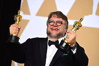 """Guillermo del Toro, winner of the awards for best director and best picture for """"The Shape of Water,"""" poses in the press room at the Oscars on Sunday, March 4, 2018, at the Dolby Theatre in Los Angeles. (Photo by Jordan Strauss/Invision/AP)"""