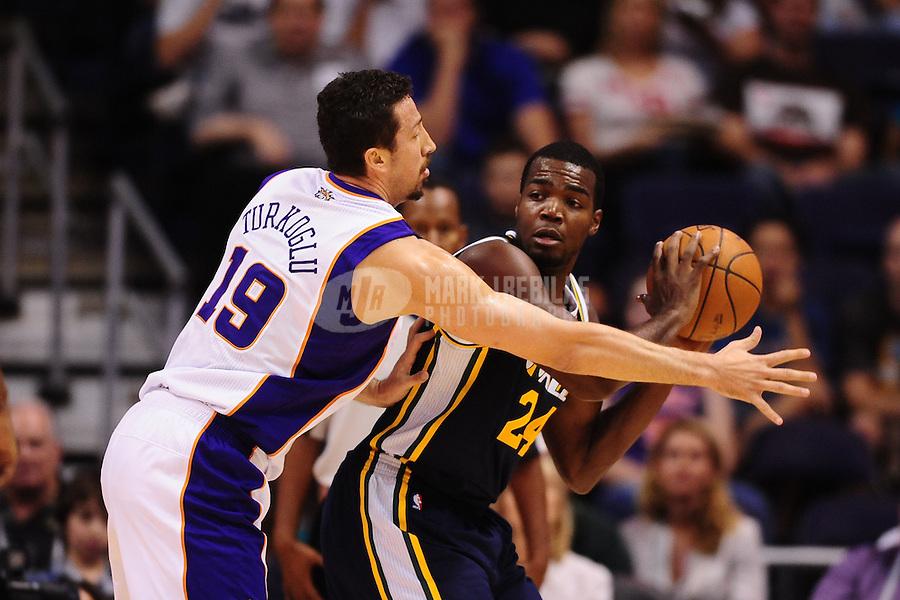 Oct. 12, 2010; Phoenix, AZ, USA; Utah Jazz forward (24) Paul Millsap is defended by Phoenix Suns forward (19) Hedo Turkoglu during a preseason game at the US Airways Center. Mandatory Credit: Mark J. Rebilas-