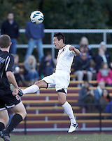 Boston College midfielder/defender Colin Murphy (21) heads the ball. Brown University (black) defeated Boston College (white), 1-0, at Newton Campus Field, October 16, 2012.