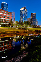 This is a vertical capture of the Sabine to Bagby promenade over the Buffalo Bayou with the Houston Skyline at the blue hour. We capture a pano image so we could capture the skyline and bridge with their reflections in the waters of the bayou in downtown Houston.