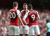 9th September 2017, Emirates Stadium, London, England; EPL Premier League Football, Arsenal versus Bournemouth; Granit Xhaka of Arsenal taking tactics to Shkodran Mustafi and Alexandre Lacazette of Arsenal
