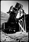 Truck (with tracked drive) from St. Louis Tunnel Works in a gondola at the Rico loading dock.  Truck is a 1927 Linn Republic Model 60 half-track.<br /> RGS  Rico, CO  ca. 1928-1930
