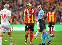 20191102 – Lens , France : Guillaume Gillet (27) of Lens pictured with Fabien Lemoine (18) of Lorient and referee Benoit MILLOT during a French Ligue 2 soccer game between Racing Club de Lens and FC Lorient , a football game on the 13th matchday in the French second league, on saturday 2 nd of November 2019 at the Stade Bollaert Delelis in Lens , France . PHOTO SPORTPIX.BE   DAVID CATRY