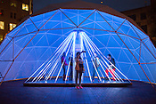 Durham, North Carolina - Thursday May 19, 2016 - The interactive art installation next to the 21c Hotel includes luminescent rods that light up when touched.