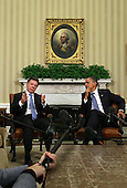 President Juan Manuel Santos of Columbia (R) speaks as U.S. President Barack Obama (R) listens during their meeting April 7, 2011 in the Oval Office of the White House in Washington, DC. Both Presidents were expected to approve the recently agreed-upon Action Plan Related to Labor Rights and to discuss next steps with regard to the U.S.-Colombia Trade Promotion Agreement, according the a White House news release. .Credit: Alex Wong / Pool via CNP